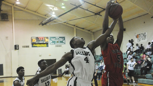 Dallas County's Josh Benford battles a Sumter Central player for a rebound during last week's game in Plantersville.  The Hornets will face Wilcox Central at Sumter Central in the first round of the class 5A, area 6 tournament next week. --File Photo