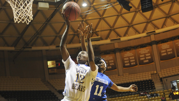 Keith's Harriet Winchester shoots a layup during Thursday's game against Notasulga. --Daniel Evans