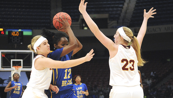 Keith's Harriet Winchester was double teamed throughout Monday's 50-34 loss to Spring Garden in the 1A girls state semifinal in Birmingham. --Daniel Evans