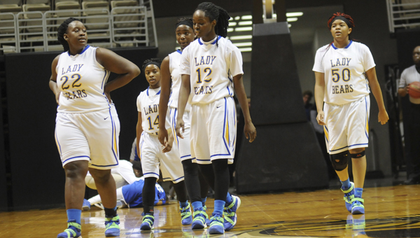 The Keith girls walk off the court during a timeout during their win last week. Keith had its games Tuesday postponed until Thursday due to severe weather. --Daniel Evans