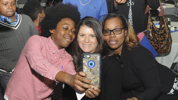 Soccer legend Mia Hamm poses for a photo Thursday after speaking at the George P. Evans Reception Hall. --Daniel Evans
