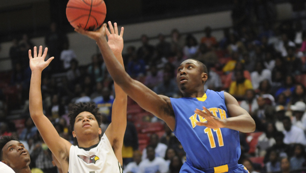 Keith's John Pettway shoots the ball against Sacred Heart during Monday's class 1A state semifinal game. --Daniel Evans