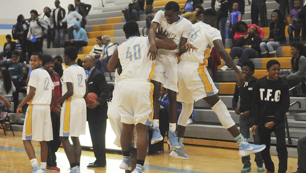 Selma players celebrate their come from behind win over Demopolis Friday night. —Daniel Evans
