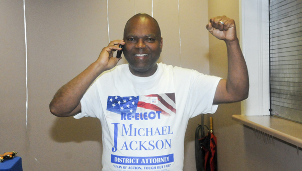 District Attorney Michael Jackson celebrates after hearing results from Wilcox County on Tuesday night at the Central Alabama Farmers Coop. Jackson beat challenger Faya Toure with 69 percent of the vote. --Chelsea Vance