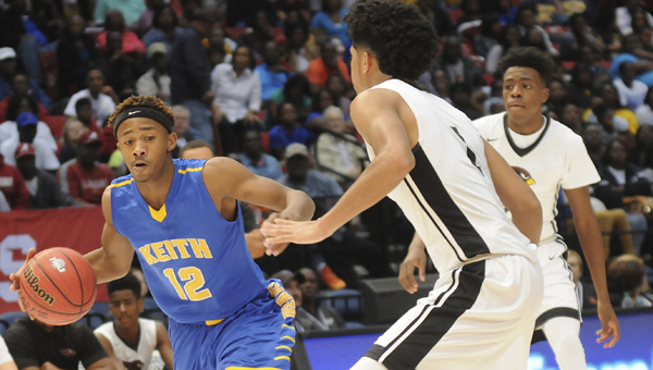 Keith's Justyn Pettway looks for dribbling room in a class 1A state tournament game against Sacred Heart.  The Keith boys joined the Keith girls this season in becoming one of just five teams in Alabama whose boys and girls teams made it to the final four teams in their state tournament.  Both Keith teams lost Thursday in Birmingham. — Daniel Evans