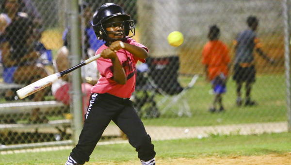 Haley Jackson swings a bat during a youth softball game last summer.  The Dallas County Commission approved the construction of four batting cages at the Sportsplex on Feb. 22.  The cages will be ready for the start of the youth baseball and softball seasons, which are set to begin the first weekend in April.