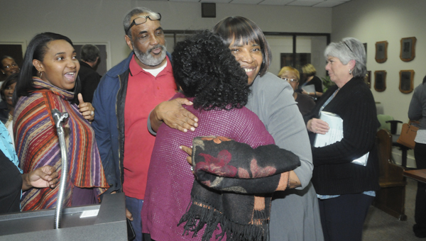 Hattie Shelton hugs her daughter Krista Shelton after being named the Dallas County School System's next superintendent. --Chelsea Vance