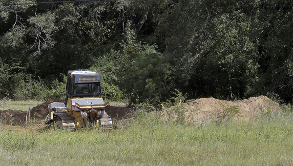 An excavator digs for two bodies that were believed to be buried off the U.S. Highway 80 Bypass. --Alaina Deshazo