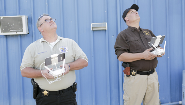Dallas County Sheriff's Department Deputy Scott Haskell and Sgt. John Treherne fly the department's drone during training Thursday. The drone will be used in search and rescues.
